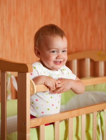 Happy baby in the crib photo