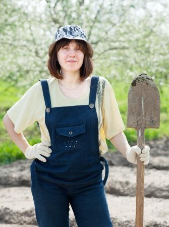 Female gardener with spade in spring photo