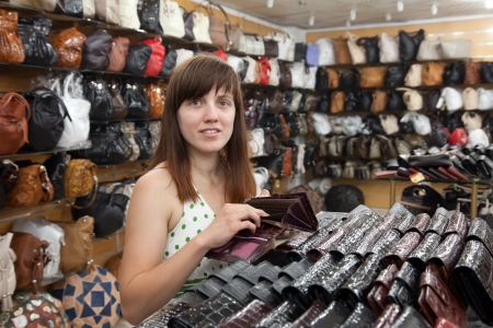 woman chooses leather wallet at   shop Stock Photo - 13697992