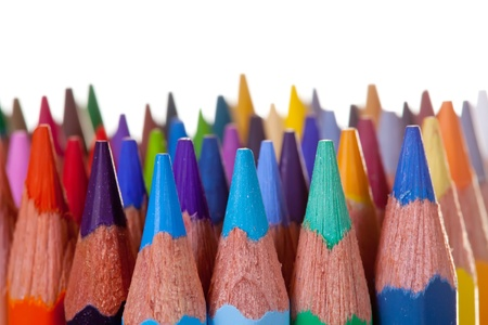 Close up of many pencils over white background photo