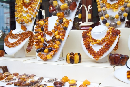14k: counter with amber jewelry in store window Stock Photo