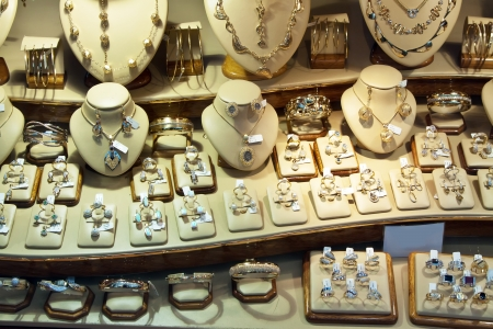 jewelry store: counter with variety jewelry in store window