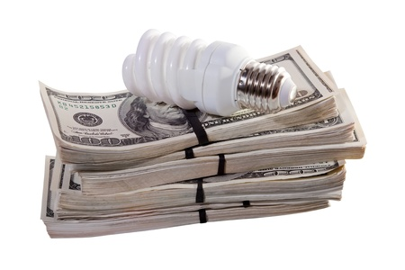 florescent light: Compact florescent light bulb on money. Isolated on white background