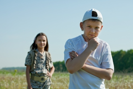 teenager boy and girl  having conflict at park photo