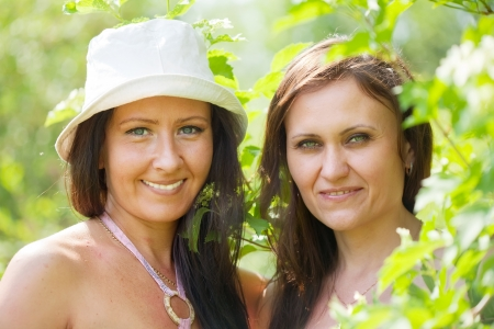 portrait of two happy women in spring  garden Stock Photo - 13831609