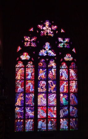 stained-glass window in Saint Vitus Cathedral.  Prague,  Czech Republic photo