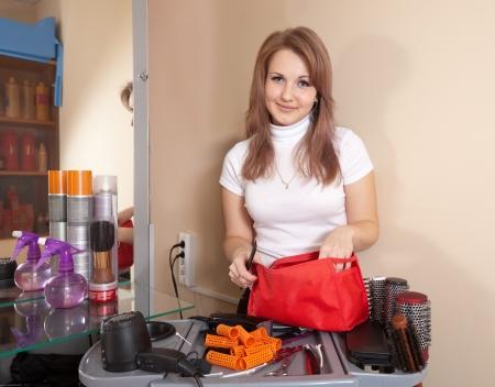 hairtician: Happy hairdresser in hair salon Stock Photo