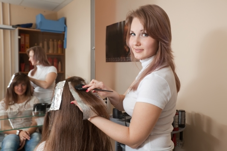 Hairdresser coloring   long-haired girl hair 