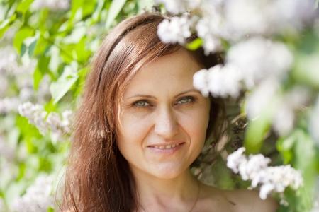 Outdoor portrait of  woman in spring  garden Stock Photo - 13880043
