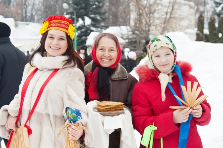 sudarium: Women in traditional  clothes with pancake during  Shrovetide Stock Photo