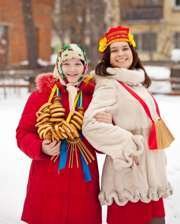 sudarium: Two happy girls celebrating  Maslenitsa festival at Russia Stock Photo