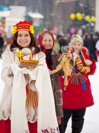 sudarium: Young woman with pancake during  Shrovetide at Russia