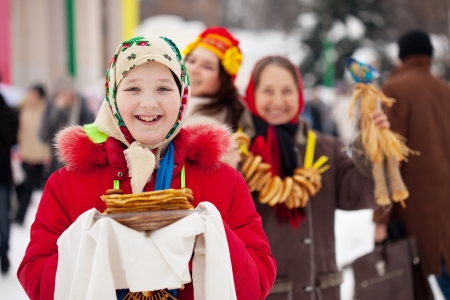 Teen girl with pancake during  Shrovetide at Russia photo