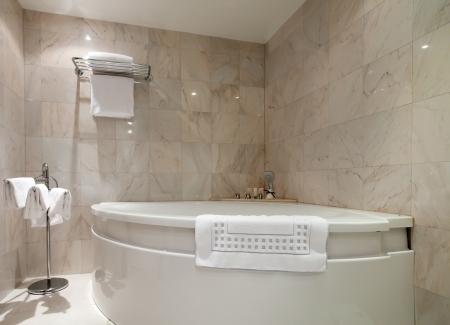 Interior of bathroom with corner bathtub