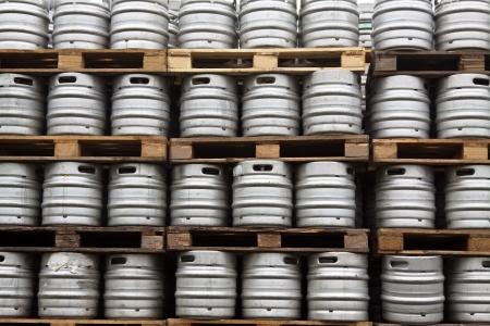 kegs: Many metal kegs of beer in regular rows