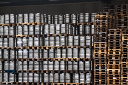 Many metal kegs of beer in regular rows Stock Photo - 13954013