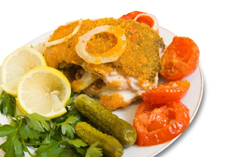 stuffed fish: Closeup of stuffed fish on plate. Isolated over white