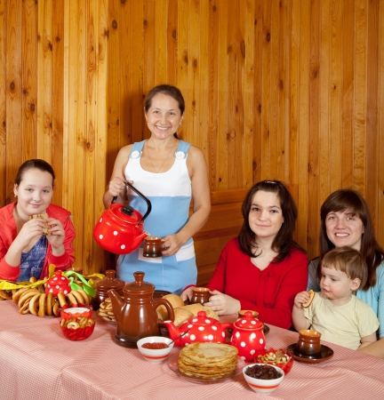 Happy family  drinking tea with russian traditional snack Stock Photo - 13982451