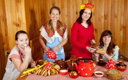 Women drinking tea with russian traditional snack  photo
