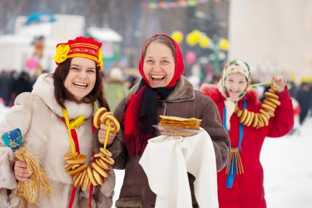 women plays during Pancake Week at Russia photo