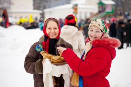 women eats pancake during Pancake Week at Russia photo