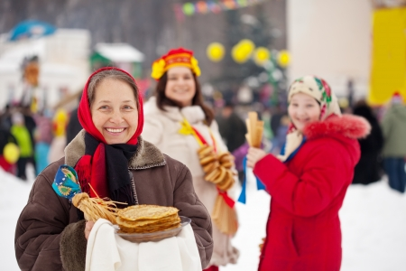 Mature woman with pancake during  Shrovetide at Russia photo