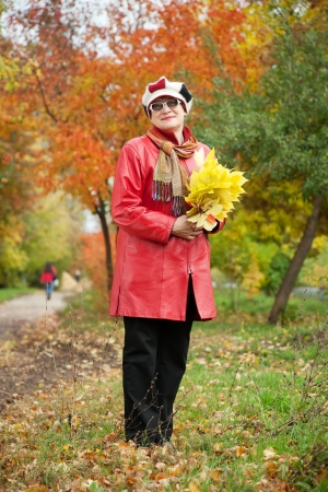 Full length shot of mature woman  in autumn park Stock Photo - 14024756