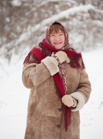 sudarium: Happy mature woman with  kerchief in winter  Stock Photo