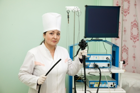 Doctor with endoscope ready for work in medical clinic Stock Photo