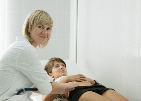 Woman doctor examining the patient in clinic photo