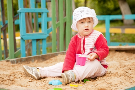two-year child playing  in sandbox photo