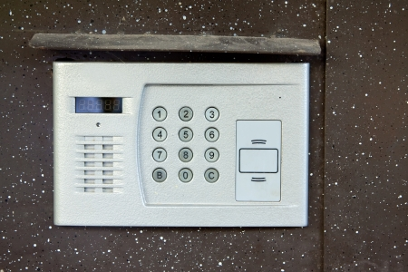 Close-up of building intercom in steel door photo