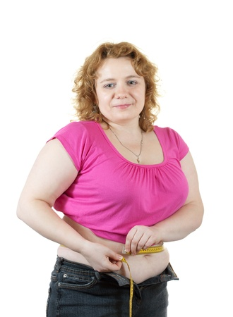 overeat: Overweight woman measuring waist with tape measure. Isolated over white background