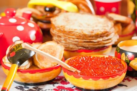 Pancake with red caviar and tea during  Pancake Week  Stock Photo - 14188358