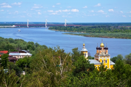 oka: View of Murom with  Nikolas church and cable bridge through Oka River. Russia Stock Photo