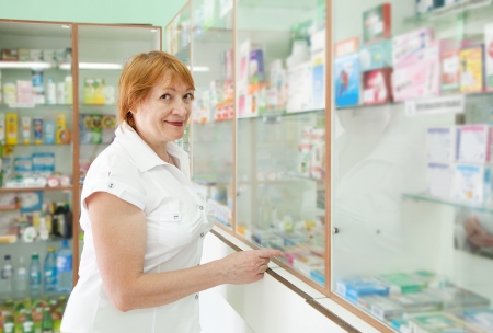 Mature woman chooses at the pharmacy photo