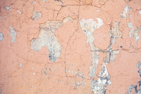 pealing: Grungy brick wall   with cracked and pealing paint