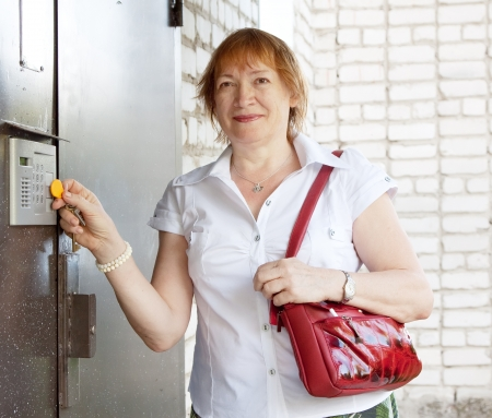 Woman opens the door with electronic key photo