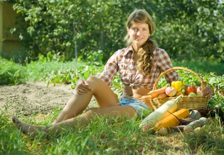 Teenage girl with  basket of fruits and vegetables photo