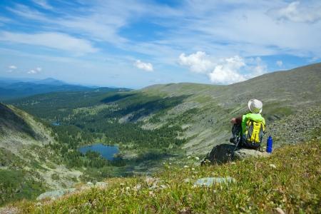 Female tourist resting at mountain pass photo