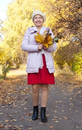 Full length shot of mature woman  in autumn park Stock Photo - 14265754