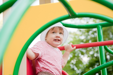 two-year child at playground area in summer photo