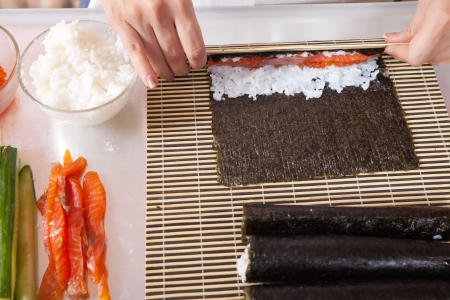 Closeup of cook making  Japanese sushi rolls   photo