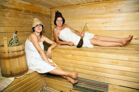 stive: Young girls is taking steam-bath  at sauna  Stock Photo