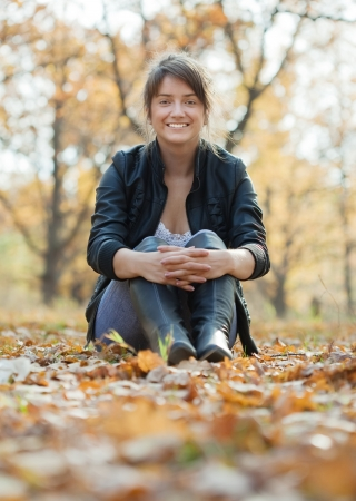 Outdoor portrait of  happy  girl  in autumn park  photo