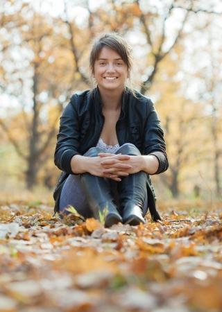 Outdoor portrait of  happy  girl  in autumn park  photo