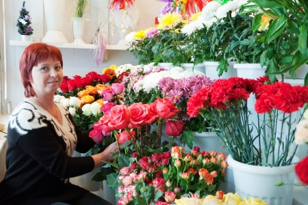 Middle-aged woman in  flower shop Stock Photo - 14431996