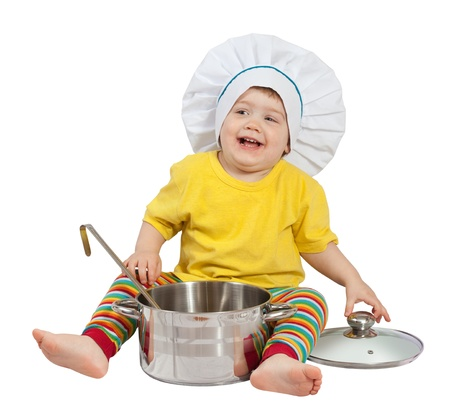 Baby cook in toque with  pan. Isolated over white background  photo