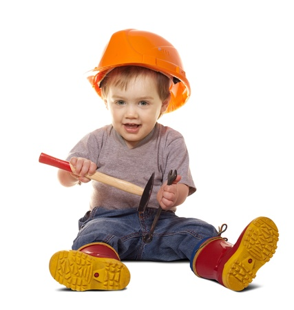 Toddler in hardhat with tools. Isolated over white background  with shade photo