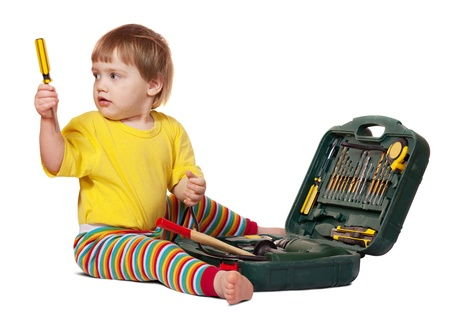 Toddler with tool box. Isolated over white background with shade photo